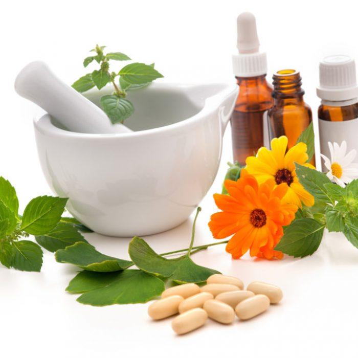 Healing herbs and amortar. Alternative medicine concept